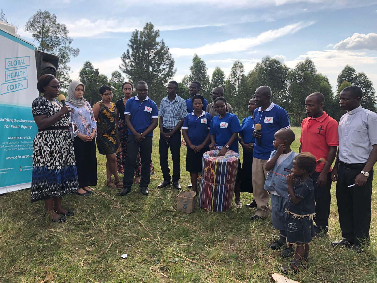 Rural Aid Foundation in partnership with Global Health handing over scholastic material to maternal mortality orphans and their father after they lost their mother in April 2018